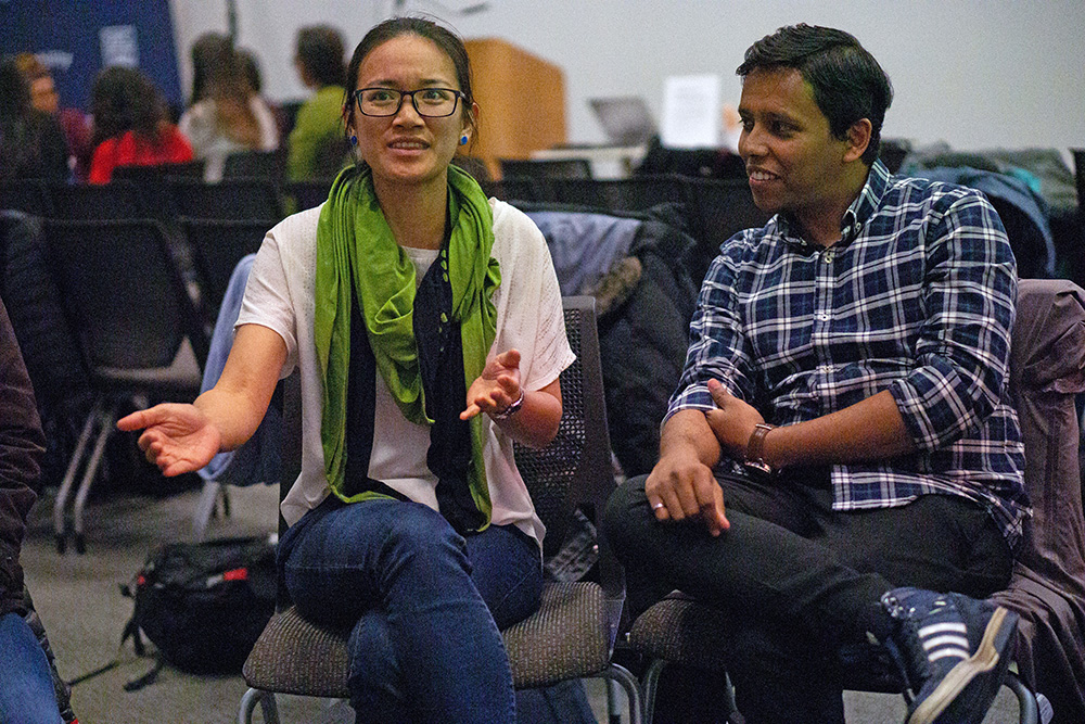 Two students in conversation at the workshop